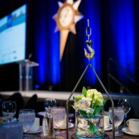 Industrial style centerpieces with large hook and chain
