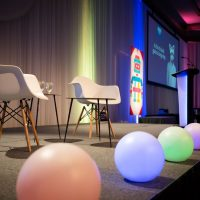 Simple stage set for honoring 2018 DEYA recipient the creator of SLACK