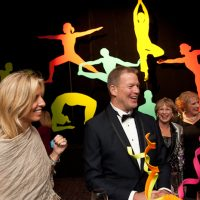 A wall of lifesized yoga figures greeted the guests at the reception
