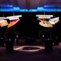 Suspended above the reception space are lightweight props representing charitable giving