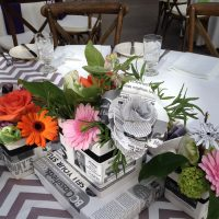 A nod to the newspaper connection with a mixture of paper flowers and fresh blooms.
